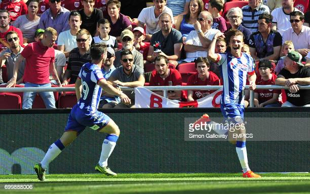 Wigan Athletic's Alex Gilbey celebrates scoring his side's first goal of the game