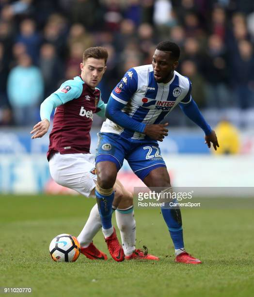 Wigan Athletic's Chey Dunkley and West Ham United's Toni Martinez during the The Emirates FA Cup Fourth Round match between Wigan Athletic and West...