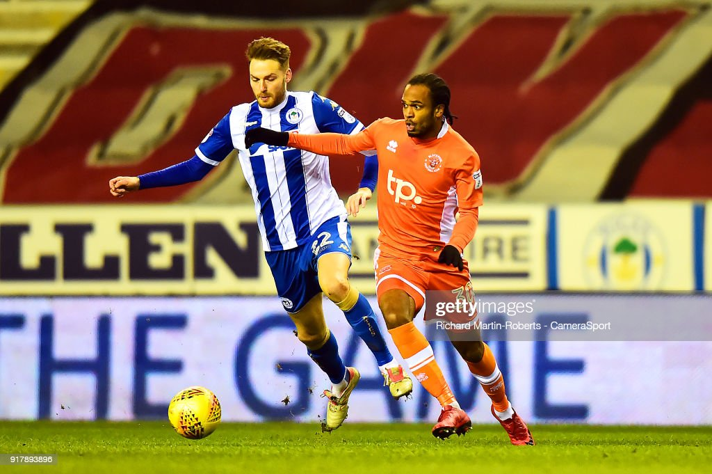 Wigan Athletic's Cheyenne Dunkley competes with Blackpool's Nathan Delfouneso during the Sky Bet League One match between Wigan Athletic and Blackpool at DW Stadium on February 13, 2018 in Wigan, England.