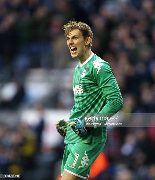 Wigan Athletic's Christian Walton celebrates during the The Emirates FA Cup Fourth Round match between Wigan Athletic and West Ham United at DW...