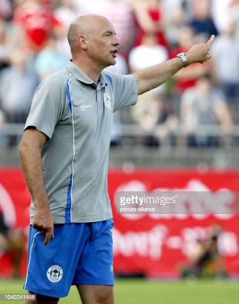 Wigan Athletic's coach Uwe Roessler reacts during the tryout match between Fortuna Duesseldorf and Wigan Athletics at the PaulJanes stadion in...