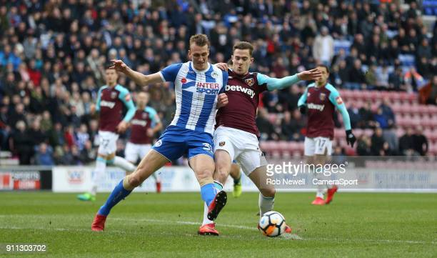Wigan Athletic's Dan Burn and West Ham United's Toni Martinez during the The Emirates FA Cup Fourth Round match between Wigan Athletic and West Ham...
