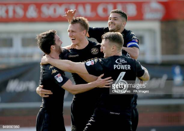 Wigan Athletic's Dan Burn celebrates with his teammates after he scores his sides third goal during the Sky Bet League One match at Highbury Stadium...