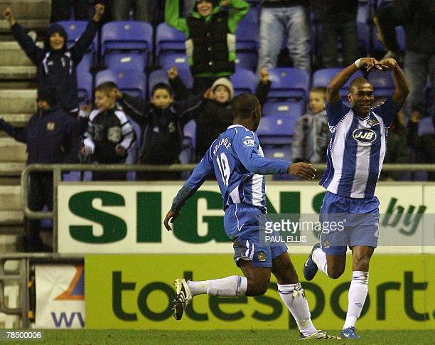 Wigan Athletic's English forward Marcus Bent is congratulated by English defender Titus Bramble Blackburn Rovers during their English Premiership...