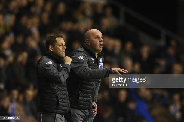 Wigan Athletic's English Manager Paul Cook gestures during the English FA Cup fifth round football match between Wigan Athletic and Manchester City...