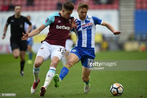 Wigan Athletic's English midfielder Michael Jacobs vies with West Ham United's English defender Reece Burke during the English FA Cup fourth round...