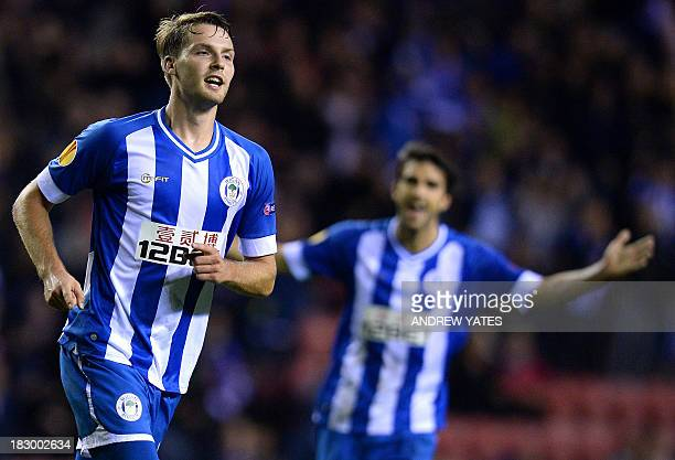 Wigan Athletic's English midfielder Nick Powell celebrates after scoring his team's third goal during the UEFA Europa League group D football match...