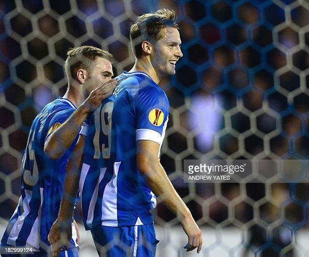 Wigan Athletic's English midfielder Nick Powell celebrates scoring the opening goal with English forward Callum McManaman during the UEFA Europa...