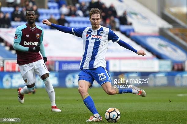 Wigan Athletic's English midfielder Nick Powell has an unsuccessful shot during the English FA Cup fourth round football match between Wigan Athletic...