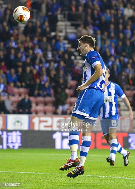 Wigan Athletic's English midfielder Nick Powell heads the opening goal during the UEFA Europa League group D football match between Wigan Athletic...