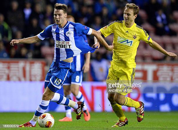 Wigan Athletic's English midfielder Nick Powell vies with NK Maribor's Slovenian midfielder Ales Mertelj during the UEFA Europa League group D...