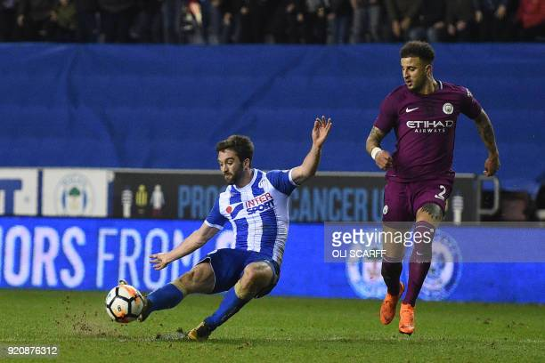 Wigan Athletic's Englishborn Northern Irish striker Will Grigg scores his team's first goal during the English FA Cup fifth round football match...