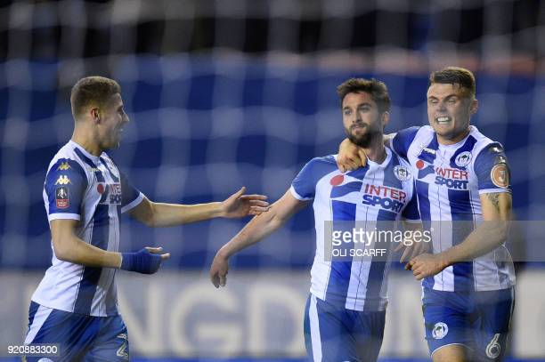 Wigan Athletic's Englishborn Northern Irish striker Will Grigg celebrates with teammates scoring his team's first goal during the English FA Cup...