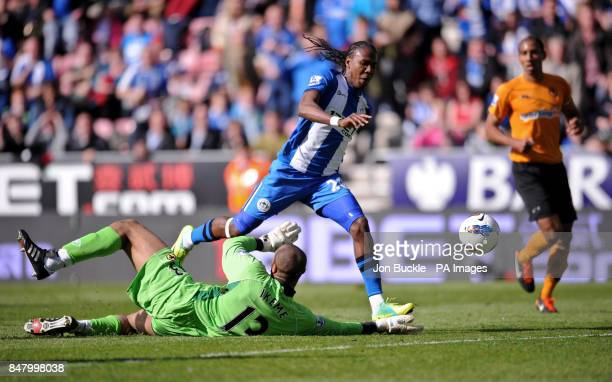 Wigan Athletic's Hugo Rodallega is challenged by Wolverhampton Wanderers' Carl Ikeme during the Barclays Premier League match at the DW Stadium Wigan