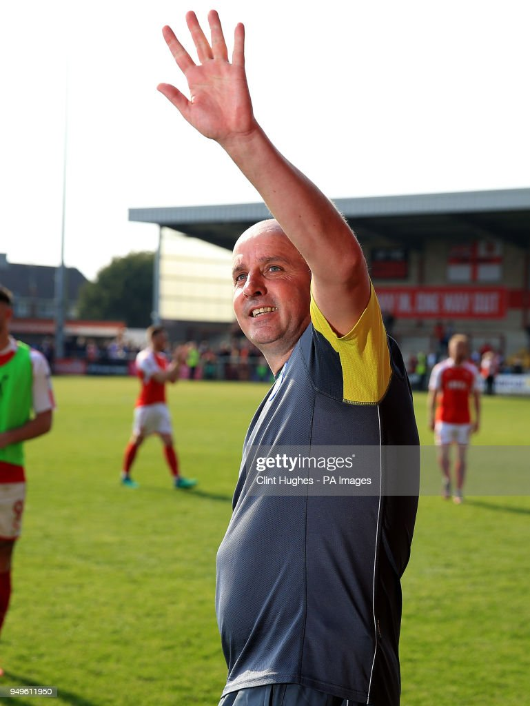 Wigan Athletic's manager Paul Cook celebrates his sides promotion to the EFL Championship during the Sky Bet League One match at Highbury Stadium, Fleetwood.