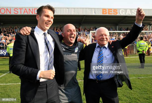 Wigan Athletic's manager Paul Cook celebrates his sides promotion to the EFL Championship with Chairman David Sharp and Owner David Whelan