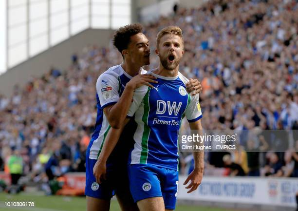 Wigan Athletic's Michael Jacobs celebrates with team mate Antonee Robinson after he scores his sides first goal of the game Wigan Athletic v...