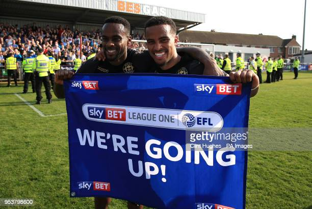 Wigan Athletic's Nathan Byrne and Cheyenne Dunkley celebrate their sides promotion to the EFL Championship