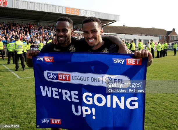 Wigan Athletic's Nathan Byrne and Gavin Massey celebrate their sides promotion to the EFL Championship during the Sky Bet League One match at...