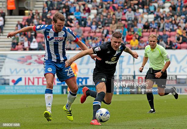 Wigan Athletic's Nick Powell battles with Blackburn Rovers' Anthony Stokes during the EFL Sky Bet Championship match between Wigan Athletic and...