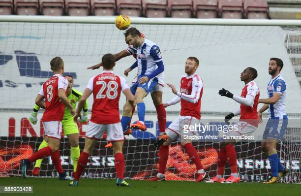 Wigan Athletic's Nick Powell beats Fleetwood Town's Nathan Pond to the ball and heads his sides first goal during the Sky Bet League One match...