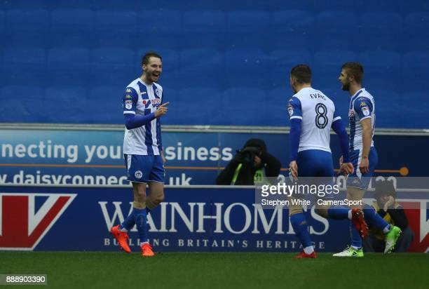 Wigan Athletic's Nick Powell celebrates scoring the opening goal with teammates Lee Evans and Michael Jacobs during the Sky Bet League One match...