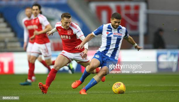 Wigan Athletic's Sam Morsy holds off the challenge from Fleetwood Town's George Glendon during the Sky Bet League One match between Wigan Athletic...