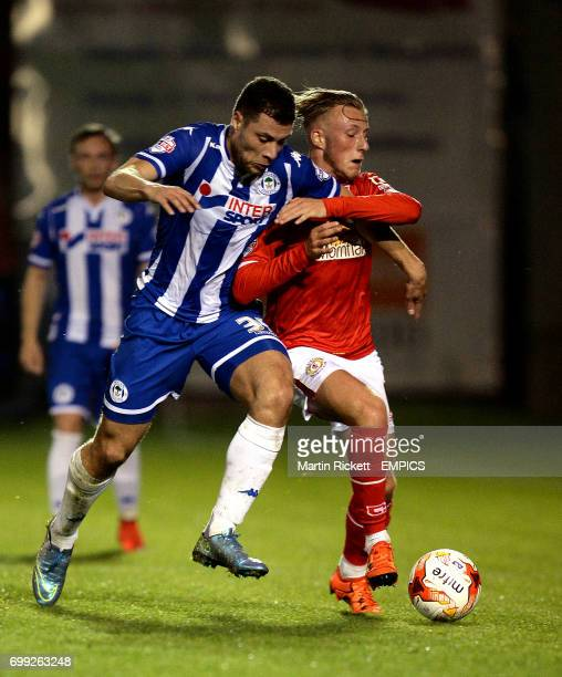 Wigan Athletic's Yanic Wildschut battles for the ball with Crewe Alexandra's George Cooper