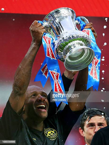 Wigan captain Emmerson Boyce lifts the trophy during the FA Cup with Budweiser Final between Manchester City and Wigan Athletic at Wembley Stadium on...