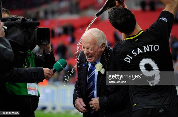 Wigan chairman Dave Whelan gets doused in champagne by his player Franco Di Santo after the Manchester City versus Wigan Athletic the FA Cup Final at...