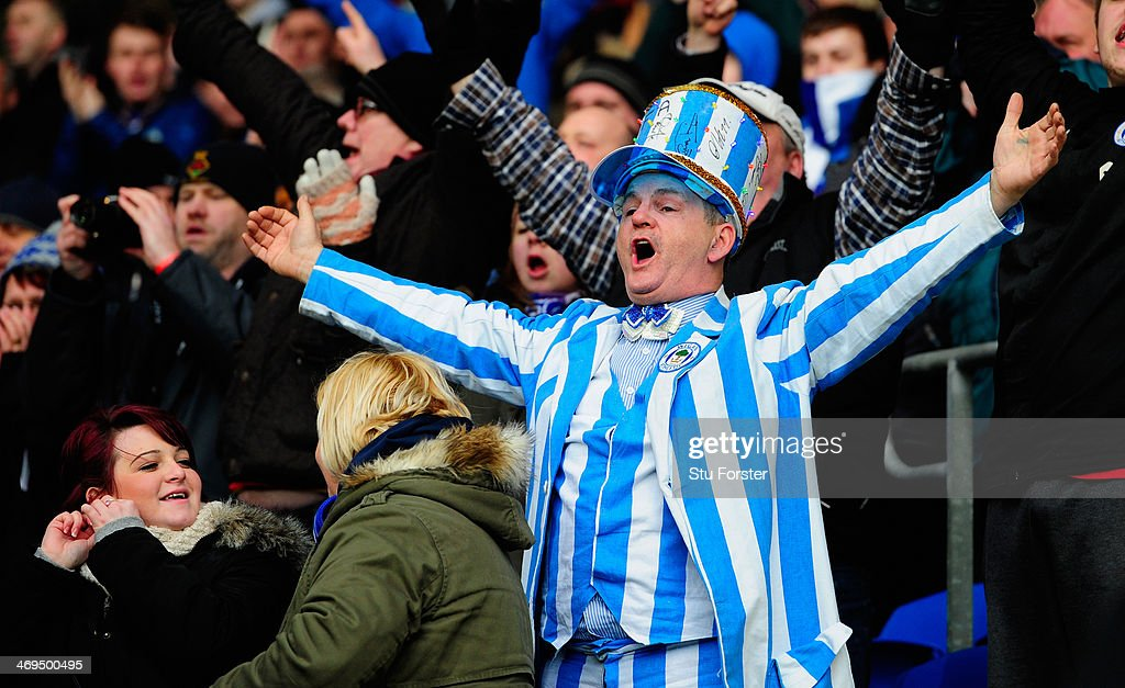 Wigan fans celebrate victory after the FA Cup Fifth Round match between Cardiff City and Wigan Athletic at Cardiff City Stadium on February 15, 2014 in Cardiff, Wales.