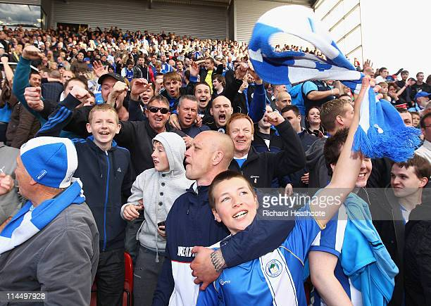 Wigan fans celebrate victory and staying in premier league during the Barclays Premier League match between Stoke City and Wigan Athletic at...