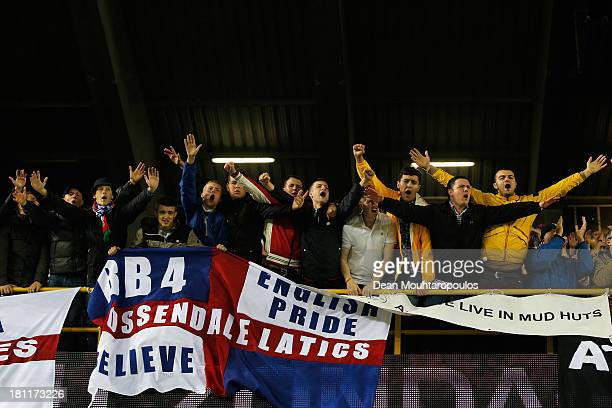 Wigan fans cheer during the UEFA Europa League Group D match between SV Zulte Waregem and Wigan Athletic at the Jan Breydelstadion on September 19...