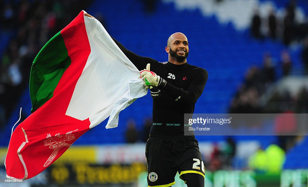 Wigan goalkeeper Ali Al-Habsi celebrates after the FA Cup Fifth Round match between Cardiff City and Wigan Athletic at Cardiff City Stadium on February 15, 2014 in Cardiff, Wales.