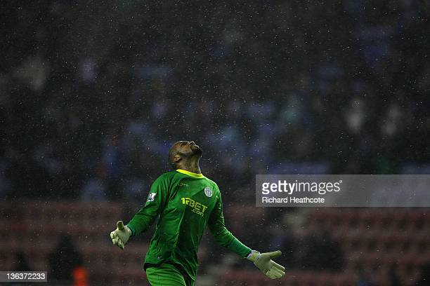 Wigan goalkeeper Ali AlHabsi looks upto the heavens as rain pours down during the Barclays Premier League match between Wigan Athletic and Sunderland...