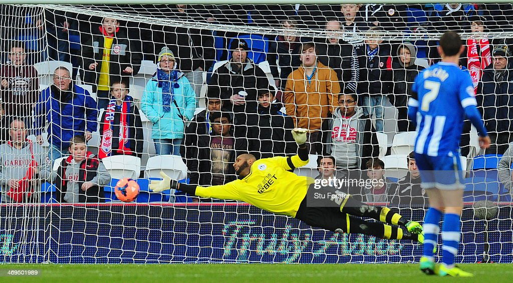 Wigan goalkeeper Ali Al-Habsi makes a fingertip save during the FA Cup Fifth Round match between Cardiff City and Wigan Athletic at Cardiff City Stadium on February 15, 2014 in Cardiff, Wales.