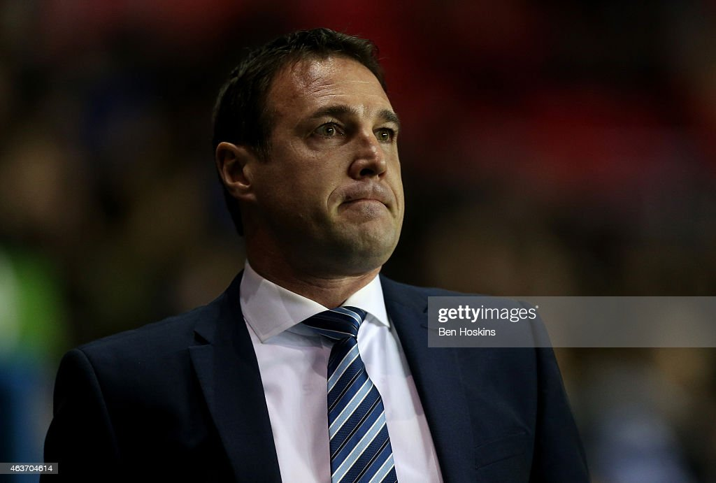 Wigan manager Malky Mackay looks on ahead of the Sky Bet Championship match between Reading and Wigan Athletic at Madejski Stadium on February 17, 2015 in Reading, England.