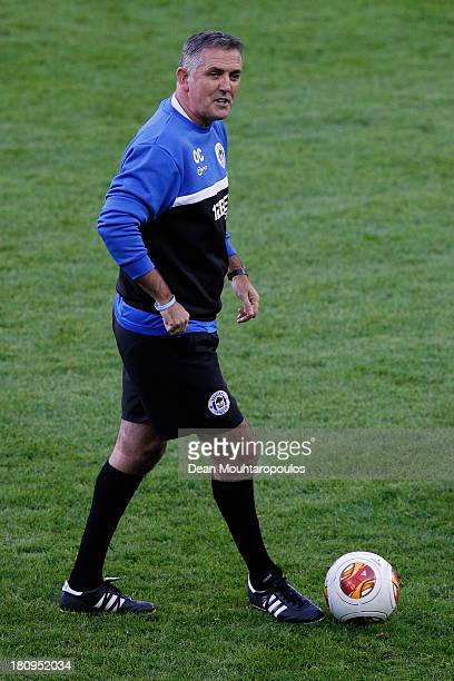 Wigan Manager Owen Coyle speaks to his players during the Wigan Athletic Training Session prior to the Europa League match between SV Zulte Waregem...