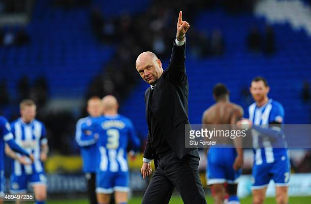 Wigan manager Uwe Rosler celebrates with the fans after the FA Cup Fifth Round match between Cardiff City and Wigan Athletic at Cardiff City Stadium...