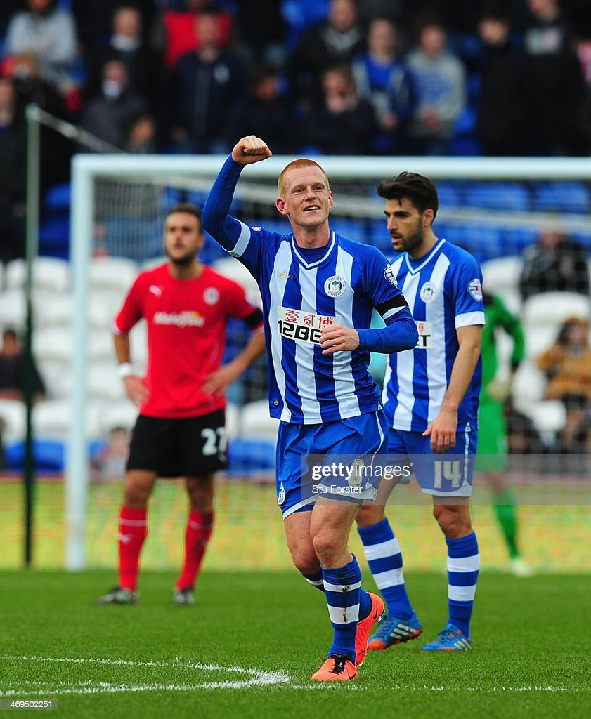 Wigan player Ben Watson (l) celebrates his goal during the FA Cup Fifth Round match between Cardiff City and Wigan Athletic at Cardiff City Stadium on February 15, 2014 in Cardiff, Wales.
