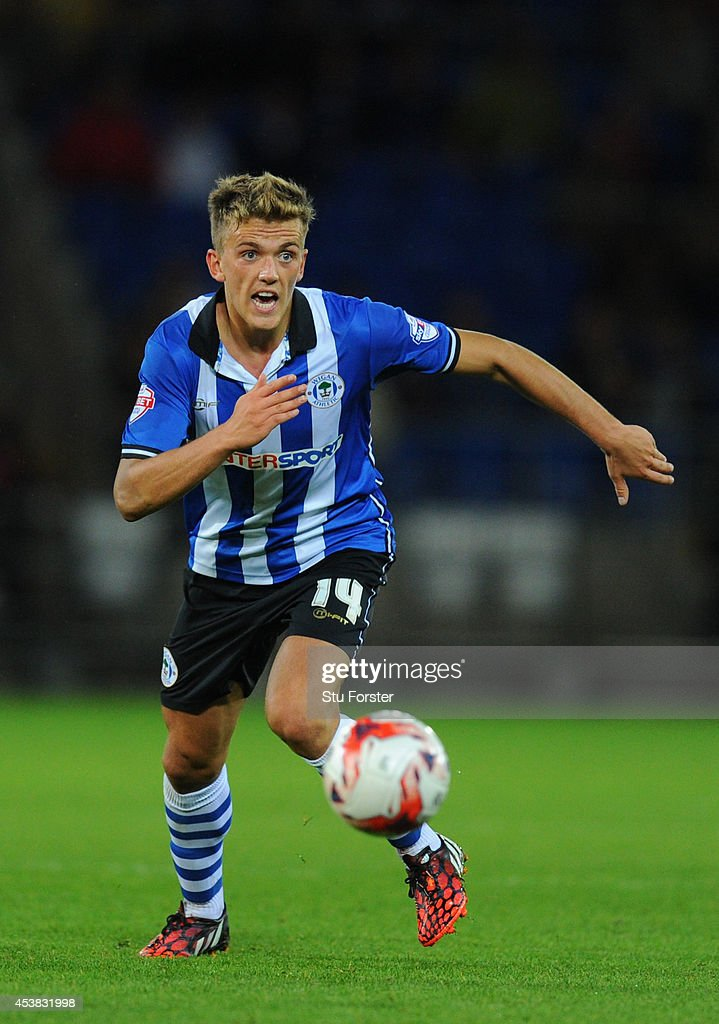 Wigan player Emyr Hughes in action during the Sky Bet Championship match between Cardiff City and Wigan Athletic at Cardiff City Stadium on August 19, 2014 in Cardiff, Wales.