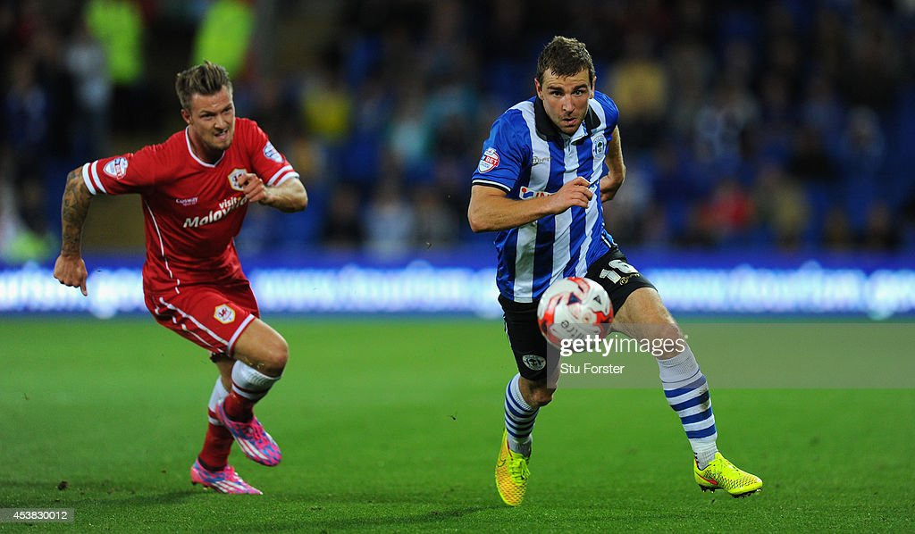 Wigan player James McArthur (r) outpaces Anthony Pilkington of Cardiff during the Sky Bet Championship match between Cardiff City and Wigan Athletic at Cardiff City Stadium on August 19, 2014 in Cardiff, Wales.