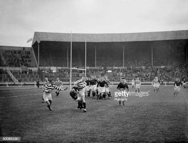 A Wigan player tackles an opponent during the first Challenge Cup Final between Wigan and Dewsbury at Wembley Stadium London 4th May 1929 Wigan won...