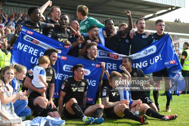 Wigan players after securing promotion to the Championship during the Sky Bet League One match between Fleetwood Town and Wigan Athletic at Highbury...