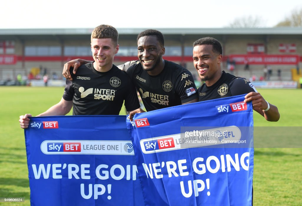 Wigan players celebrate after securing promotion to the Championship during the Sky Bet League One match between Fleetwood Town and Wigan Athletic at Highbury Stadium on April 21, 2018 in Fleetwood, England.