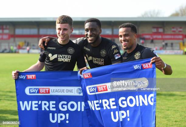 Wigan players celebrate after securing promotion to the Championship during the Sky Bet League One match between Fleetwood Town and Wigan Athletic at...