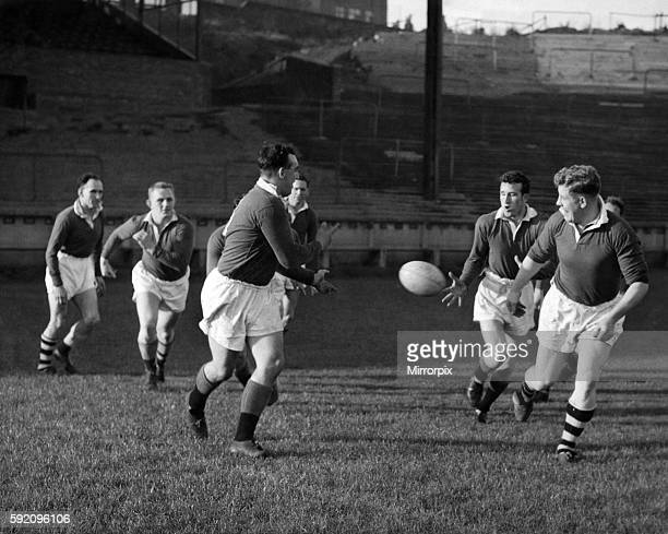Wigan players practice passing tactics during training today October 1957 P012584