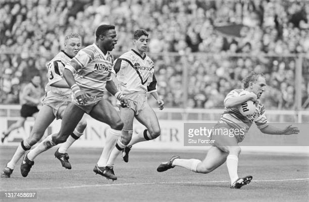 Wigan stand off Shaun Edwards crosses the line to score a try as wing Martin Offiah celebrates during The 1992 Challenge Cup Final between Wigan and...