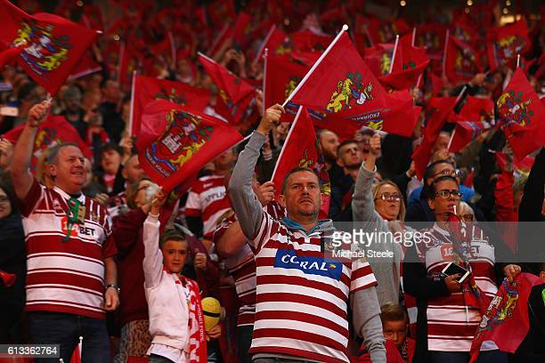 Wigan supporters greet their team during the First Utility Super League Final between Warrington Wolves and Wigan Warriors at Old Trafford on October...