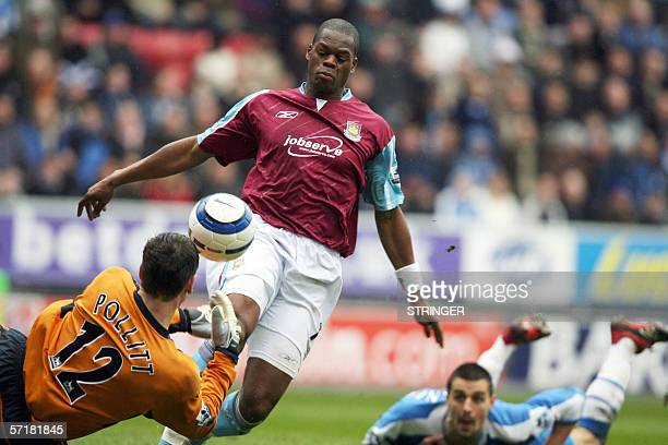 West Ham United's Marlon Harewood scores past Wigan Athletic's Mike Pollitt and Wigans defender Paul Scharner during their English Premiership...